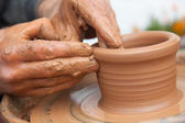 Craftsman works in clay dishes — Stock Photo