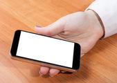 在女性手中的智能手机 — 图库照片