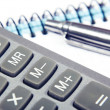 Pen with a calculator and a notebook — Stock Photo
