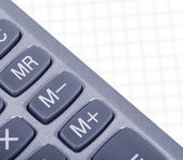 Calculator on a white paper — Stock Photo