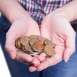 Accumulated a handful of coins — Stock Photo