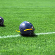 Helmet rugby lying in the field — Stock Photo