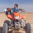 Child on ATV desert area — Stock Photo