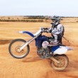 Stunts on motorcycle in desert — Stock Photo #37323625