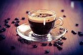 Glass cup of aroma coffee crema — Stock Photo