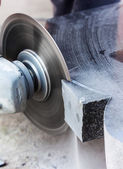 Rough machining of solid stone grinder — Stock Photo