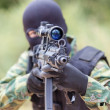 Soldier with a gun sighting optics — Stock Photo #46259609