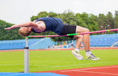 Athlete jumps in height — Stock Photo