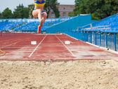 Execution of the triple jump — Stock Photo
