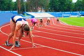 Sportswomen at the start — Stock Photo