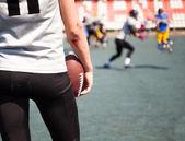 Athlete American football with broken elbows — Stock Photo
