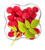 Raspberries view from the top and a green leaf — Stock fotografie