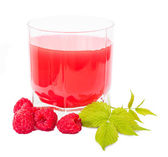 Glass with juice and placer raspberries — Stock Photo