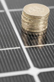 Macro PV Solar Panel and money. — Stok fotoğraf