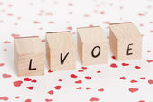 Love Written With Wooden Blocks. — Stock Photo