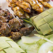 Chicken and Mutton Satay with Ketupat and Cucumbers — Stock Photo