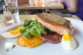 Pan Seared Salmon Filet with Vegetables and Eggs — Stock Photo