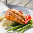 Grilled Salmon Filet Over Basmati Rice - Stock Photo