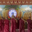 Buddhist Monks Worshipping Buddha in Temple — Stock Photo