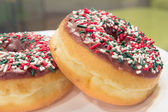 Donuts with Christmas Sprinkles Closeup — Stockfoto