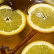Boiling Apple Cider with Orange Slices - Stock Photo