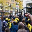 Stock Photo: Spectators with CamerPhones Recording Occupy Portland Protest