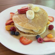 Stock Photo: Hotcakes with Banana Berries and Honey