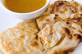 Indian Roti Prata with Curry Sauce Closeup — Stock Photo