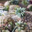 Pineapples in Basket Closeup - Stock Photo