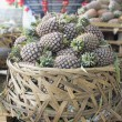 Постер, плакат: Pile of Pineapples in Big Basket