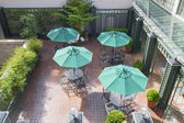 Outdoor Patio Seatings with Umbrellas — Stock Photo