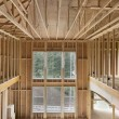 Stock Photo: New Construction Home High Ceiling Wood Stud Framing