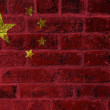 Постер, плакат: Peoples Republic of China Flag on Brick Wall