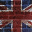 UK Flag on Brick Background - Stock Photo