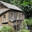 Cedar Creek Grist Mill is a historic grain grinding mill in Washington that has maintained its original structural integrity, grinds with stones and is water powered — Stock Video