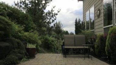 Timelapse of Backyard Patio Garden with Moving White Clouds Blue Sky and Window Reflection 1920x1080 — Stock Video