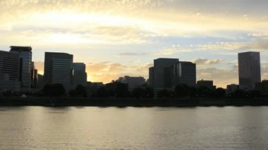 Beautiful Sunset Along Willamette River Esplanade Time Lapse with Downtown City Skyline View in Portland Oregon 1920x1080 — Stock Video