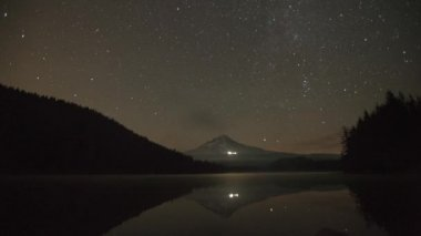 Perseid Meteor Shower in Trillium Lake with Mount Hood, Brightly Lit Timberline Lodge and Water Reflection Time Lapse 1920x1080 — Stock Video
