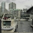 Water Traffic with Seabuses Taxis and Highrise Condominium Buildings along Burrard Inlet in Granville Island Vancouver BC Canada 1080p — Stock Video