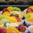 Stock Photo: Lemon Custard Tarts with Fruits Closeup