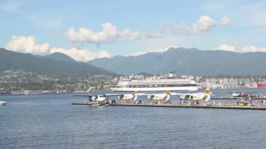 Seaplane Docks with Float Planes Moving Cruise Ship and Sea Bus along False Creek in Vancouver BC Canada with View of Mountain and North Vancouver Time Lapse 1920x1080 — Stock Video