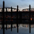 Stock Video: Portland Oregon Hawthorne Bridge Closeup across Willamette River Beautiful Water Reflection Downtown at Blue Hour 1080p