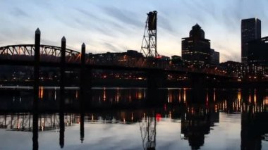Portland Oregon City Skyline with Hawthorne Bridge across Willamette River at Blue Hour Panning 1080p — Stock Video