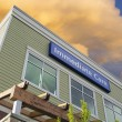 Immediate Care Sign On Hospital Building with Clouds — Stock Photo