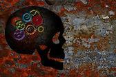 Rusty Gears on Skull Grunge Texture Background — Stock Photo