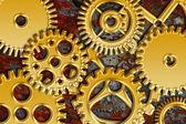 Engrenagens de ouro sobre fundo de textura grunge — Fotografia Stock