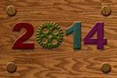 2014 Wooden Gear on Wood Grain Texture Background — Stock Photo