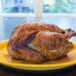 Cooked Whole Turkey on Yellow Platter — Zdjęcie stockowe
