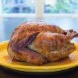 Cooked Whole Turkey on Yellow Platter — Stock Photo