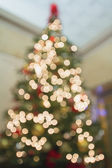 Christmas Tree Perspective Defocused with Bokeh Lights — Stock Photo